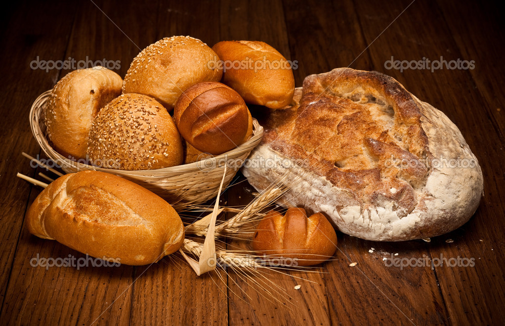 Assortment of baked bread on wood table — Stock Photo #1333321