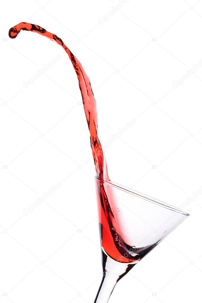Red Martini being poured in a martini glass; isolated on a white background. — Lizenzfreies Foto #1337851
