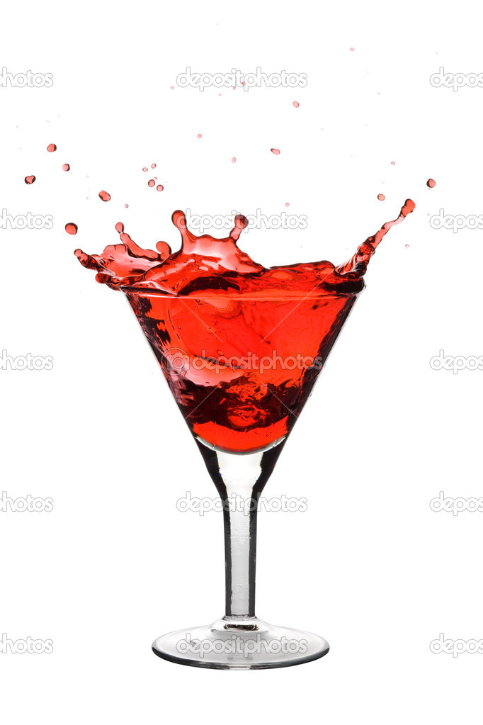 Red Martini being poured in a martini glass; isolated on a white background. — Stock Photo #1337856