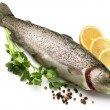 Raw fish with lemon, parsley, spice - Stock Photo