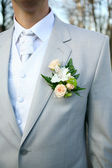 The groom at a wedding ceremony. Boutonniere for jacket — Stock Photo