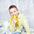 Stock Photo: Boy eats a banana