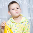 Boy eats a banana — Stock Photo