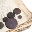 Old book and coins — Stock Photo