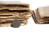 Coin and old books — Stock Photo