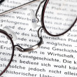 Glasses on dictionary — Stock Photo