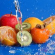 Water drops around fruits — Stock Photo #1408177
