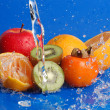 Water drops around fruits — Stock Photo