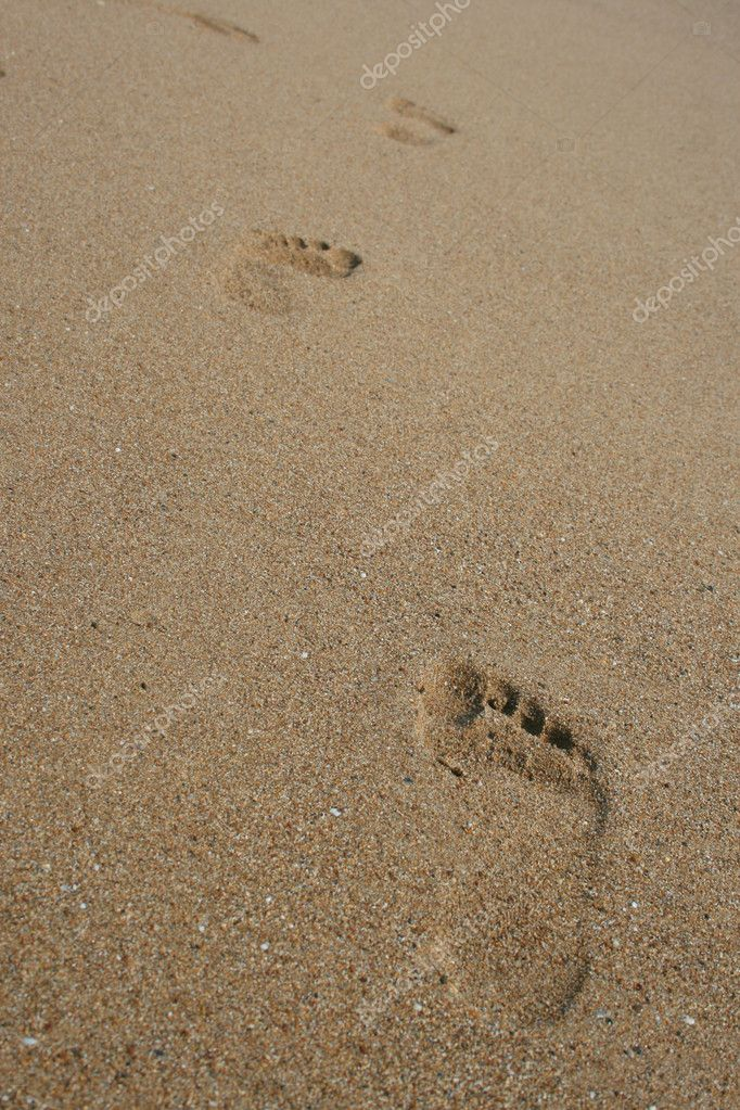 Human tracks on the sand of a beach — Stock Photo #1203518
