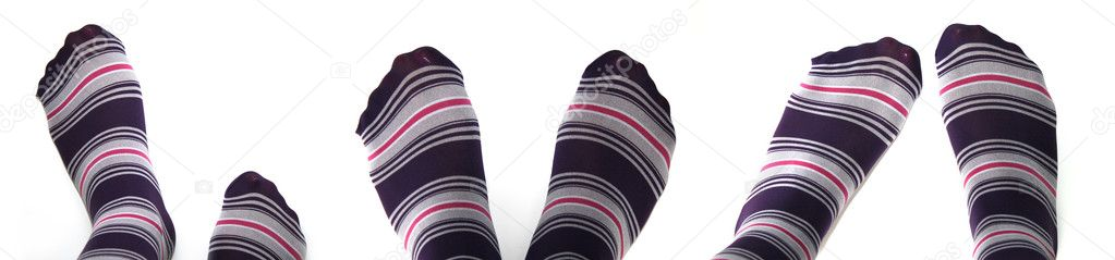 Beautiful legs in funny socks over white — Stock Photo #1203866
