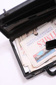 Briefcase with a newspaper — Stock Photo