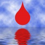 červená kapka na oceánu — Stock fotografie