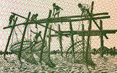 Men fishing with stick nets — Stock Photo