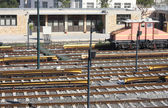Railway tracks and depot with train — Stock Photo