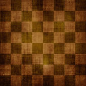 Vintage shabby chessboard — Stock Photo