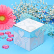 Flower and gift — Stock Photo
