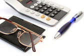 The handle and the calculator — Stock Photo
