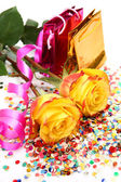Roses and a streamer — Stock Photo