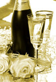 Champagne en rozen — Stockfoto
