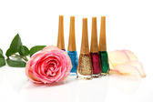 Color varnish and rose — Stock Photo