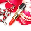 Petals of roses and lipstick — Stock Photo