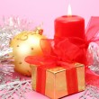 Candle and gift — Stock Photo