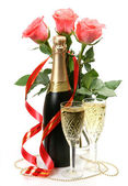 Pink roses and champagne — Stock Photo