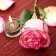Stock Photo: Candle and rose