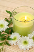 Flowers and candle — Stock Photo