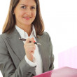 Smiling young business woman isolated on — Stock Photo