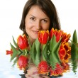 Woman with a bouquet of tulips — Stock Photo