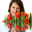 Woman with a bouquet of tulips - Stock Photo