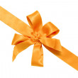 Gift golden ribbon and bow — Stock Photo