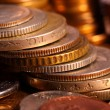 Golden piles of coins closeup — Stock Photo