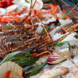 Fresh seafoods lay on an ice — Stock Photo