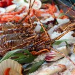Fresh seafoods lay on an ice - Stock Photo