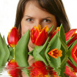 The girl with a bouquet of tulips - Stock Photo