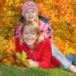 Mum with a daughter in autumn park — Stock Photo