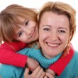 Portrait of happy mother and daughter — Stockfoto