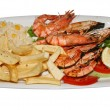 Plate with prawns and french fries - Stock Photo