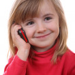Beautiful young girl speaks by phone — Stock Photo #1226960