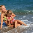 Mum with daughter have rest on sea — Stock Photo