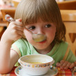 Charming little girl during a dinner — Stock Photo