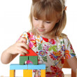 Little girl playing with cubes — Stock Photo
