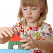 Little girl playing with cubes — Stock Photo #1228168