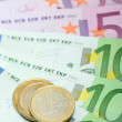 Stock Photo: Euro banknotes with various coins