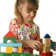 Little girl playing with cubes — Stock Photo #1228633