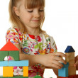 Little girl playing with cubes — Stock Photo #1228638