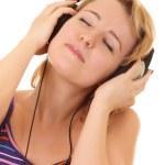 Women listening music in headphones — Stock Photo