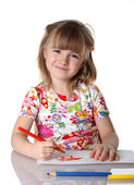 Happy little girl drawing a picture — Stock Photo